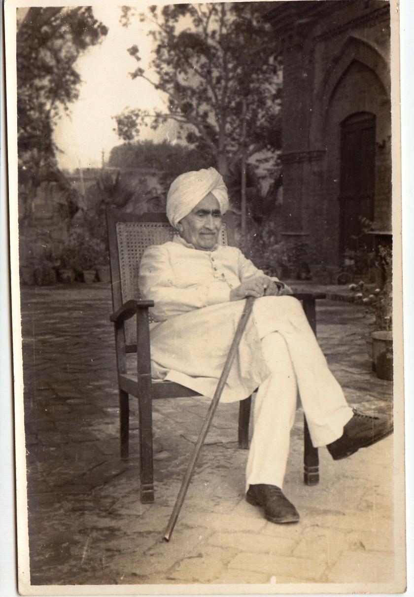 Ruchi Ram Sahni sitting in his courtyard